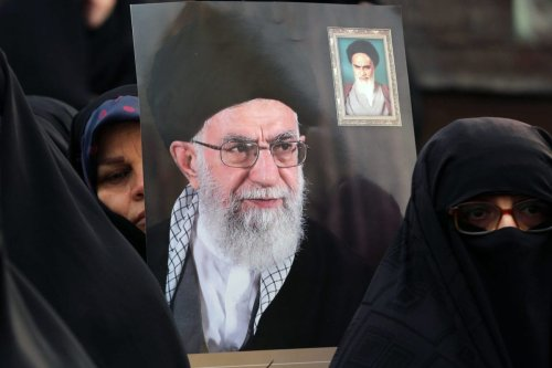 Demonstrators hold posters of Iranian Supreme Leader Ayatollah Ali Khamenei during a pro-government demonstration to react to protests due to fuel price increase of Iran, on November 25, 2019 in Tehran, Iran [Fatemeh Bahrami / Anadolu Agency]