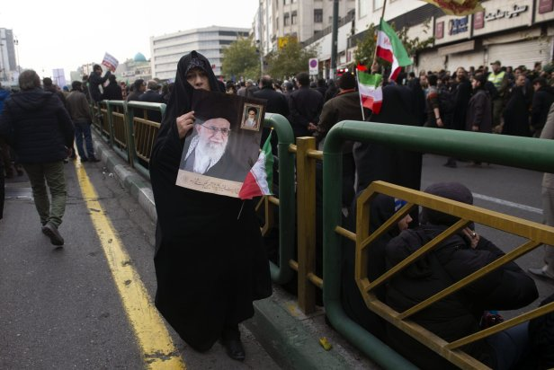 Demonstrators hold posters of Iranian Supreme Leader Ayatollah Ali Khamenei during a pro-government demonstration to react to protests due to fuel price increase of Iran, on 25 November, 2019 in Tehran, Iran [Fatemeh Bahrami/Anadolu Agency]