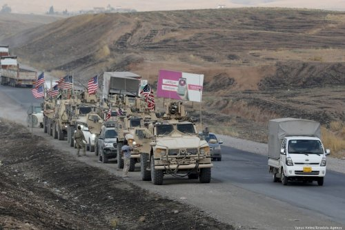A military convoy of US forces along the border of Syria on 21 October 2019 [Yunus Keleş/Anadolu Agency]