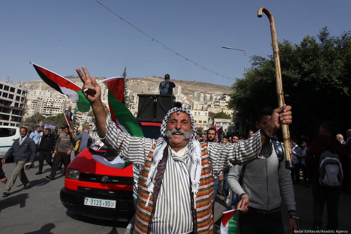 Palestinians stage a protest against the US decision on illegal Israeli settlements in Nablus, West Bank on 26 November 2019 [Nedal Eshtayah/Anadolu Agency]