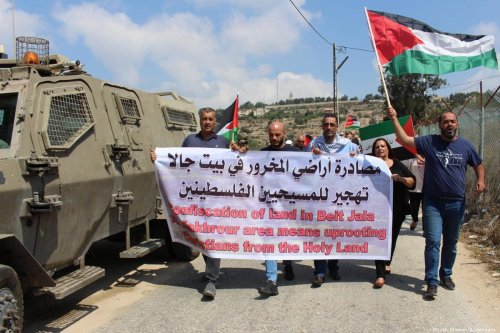 Palestinian demonstrators protest against Jewish settlements in the West Bank on 8 September 2019 [Mosab Shawer/Apaimages]