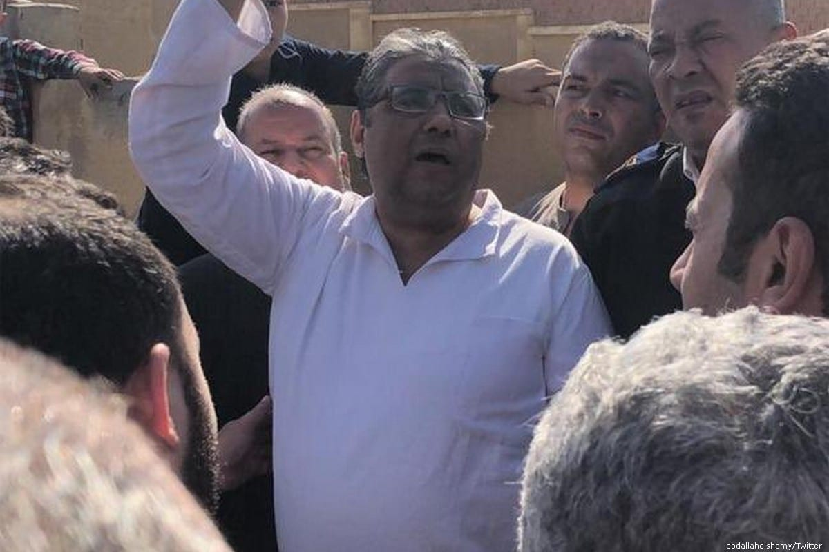 Al Jazeera journalist Mahmoud Hussein. who was arrested by Egyptian forces, can be seen at his fathers funeral on 13 November 2019 [abdallahelshamy/Twitter]
