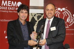Andrew Ross [left], winner of the Social History Award, seen at the 8th annual Palestinian Book Awards with Husam Zomlot, Palestinian ambassador to the UK, in London, UK, on 1 November 2019 [Middle East Monitor]