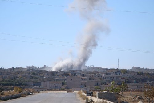 Smoke rises after Assad regime forces carried out airstrikes that targeted civil settlements at Kafr Rumah town which is a part of a de-escalation zone, in Idlib, Syria on 3 December 2019. [Ibrahim Hatib - Anadolu Agency]