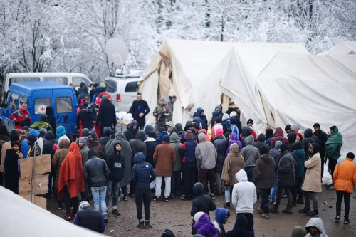 Irregular migrants, who were not allowed to cross the Croatian border and living in the camp 'Vucjak' near Bihac, reject foods, distributed by charities, as a reaction, in Bihac in Bosnia and Herzegovina on 5 December 2019. [Mustafa Öztürk - Anadolu Agency]