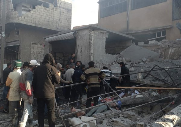 Civil defence members conduct search and rescue works at debris of a building after airstrikes by Assad regime, Russia kill 19 civilians in Bauon village of Idlib, de-escalation zone, Syria on 7 December, 2019 [Ahmet Z. Hatib/Anadolu Agency]