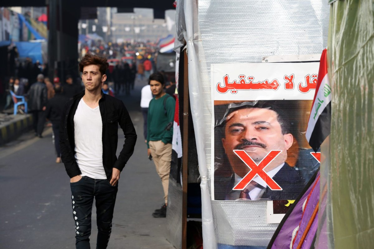 Demonstrators during an anti-government protest in Iraq on 15 December 2019 [Murtadha Sudani/Anadolu Agency]