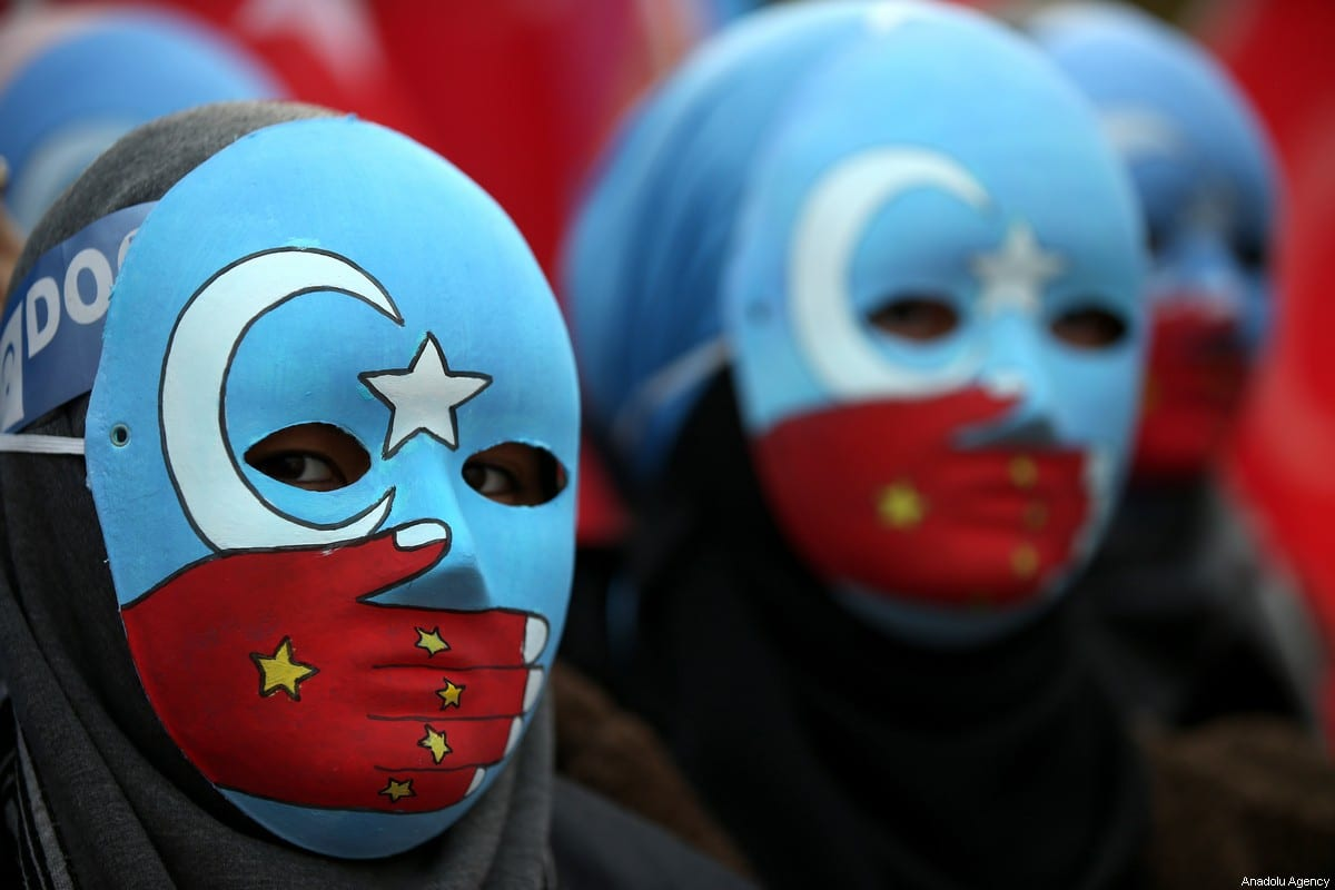 People gather to stage a demonstration in support of Uyghur Turks against human rights violations of China, at Orhangazi Park in Bursa, Turkey on December 20, 2019 [Ali Atmaca / Anadolu Agency]