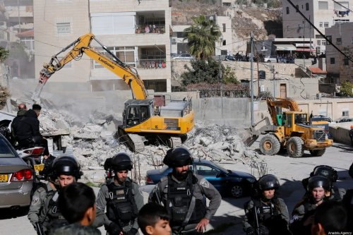 Israeli forces take security measures around the site as demolition works carried out by excavators by Israeli forces in Isawiya district of Eastern Jerusalem on 24 December, 2019 [Mostafa Alkharouf/Anadolu Agency]