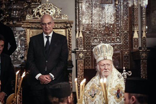 Fener-Greek Patriarch Bartholomew (R) officiates Christmas Mass held with the participation of Greek Foreign Minister Nikos Dendias (L), at the church in the Fener Greek Patriarchate's garden, in Istanbul, Turkey on 25 December 2019. [Şebnem Coşkun - Anadolu Agency]
