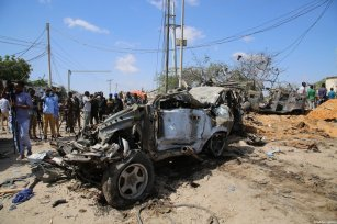 Damaged vehicle, used in the attack is seen at site after a bomb attack carried out to a checkpoint in Somalia's capital Mogadishu on December 28, 2019 [Sadak Mohamed / Anadolu Agency]