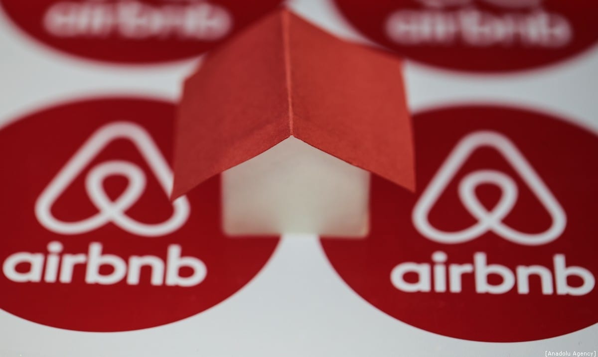 Logos of Airbnb are seen with a house mock-up onto it, on December 30, 2019 in Ankara, Turkey. [Metin Aktaş/Anadolu Agency]