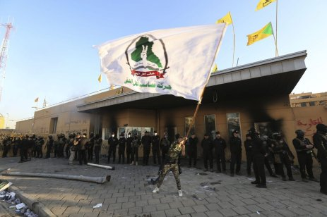 Iraqi security forces stand guard as outraged Iraqi protesters storm the US Embassy in Baghdad, protesting Washington's attacks on armed battalions belong to Iranian-backed Hashd al-Shaabi forces on 31 December, 2019 [Murtadha Sudani/Anadolu Agency]