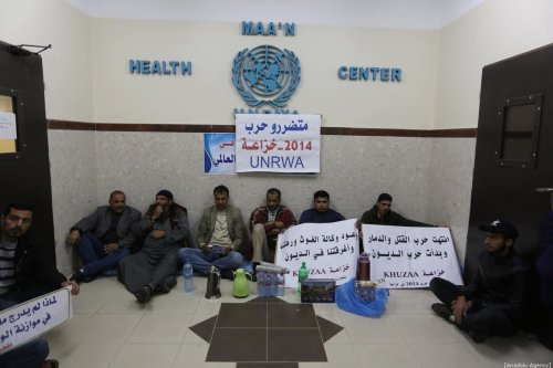 Palestinians, whose houses were damaged due to Israeli attacks on 2014, stage a sit-in protest demanding indemnity payment at UNRWA's building in Gaza City, Gaza on 9 December 2019. [ Ashraf Amra - Anadolu Agency]