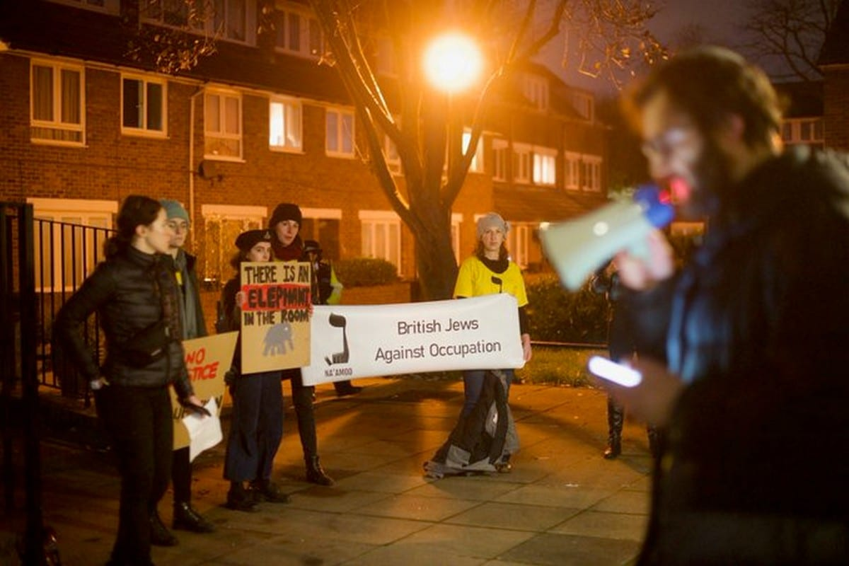 Campaigners from a British Jewish anti-occupation group block the entrance to a talk by the far-right Israeli organisation, Regavim in London, UK on 1 December 2019