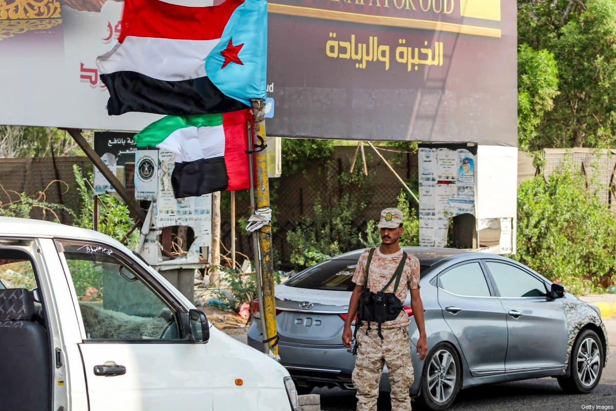 A UAE-backed Southern Transitional Council (STC) soldier stops cars at a security checkpoint in Yemen on 4 September 2019 [SALEH AL-OBEIDI/AFP/Getty Images]