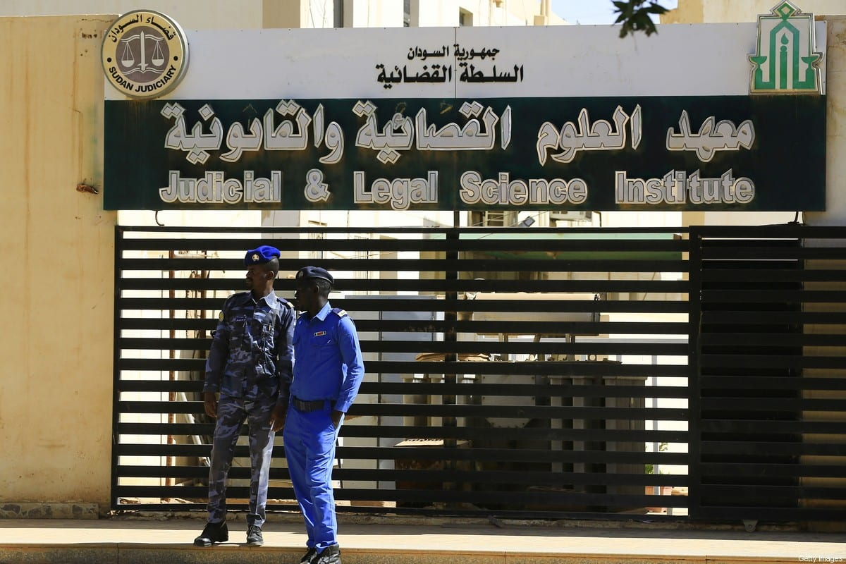 Members of Sudanese security stand guard during the trial of deposed president Omar al-Bashir for graft at a court in the capital Khartoum, on 14 December, 2019 [ASHRAF SHAZLY/AFP via Getty Images]
