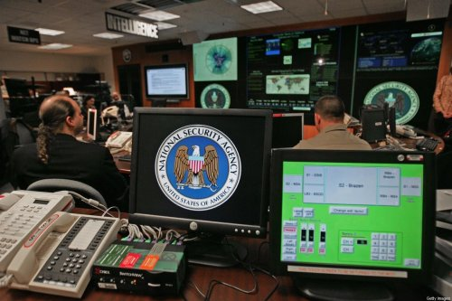 A computer workstation bears the National Security Agency (NSA) logo inside the Threat Operations Center inside the Washington suburb of Fort Meade, Maryland, intelligence gathering operation 25 January 2006 [PAUL J. RICHARDS/AFP via Getty Images]