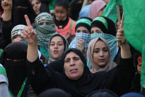 Palestinians come together to celebrate the 32nd anniversary of Hamas in Gaza on 16 December 2019 [Mohammed Asad/Middle East Monitor]