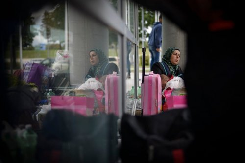 A Syrian woman at a refugee accommodation facility in Munich, Germany on 7 September 2015 [Philipp Guelland/Getty Images]