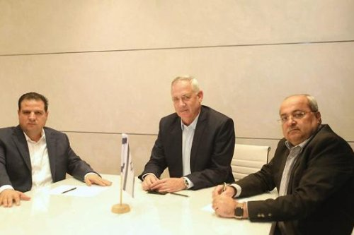 Blue and White head Benny Gantz (C) and members of the Joint List Ayman Odah (L) and Ahmad Tibi (R)