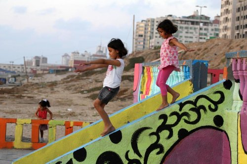 Palestinian children play on a colour stones, at park in Gaza on 11 July 2015 [Mohammed Asad/Apaimages]