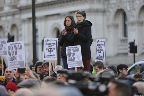 People take part in an anti-war rally following the killing of Iranian Revolutionary Guards' Quds Force commander Qasem Soleimani by a US airstrike in the Iraqi capital Baghdad, on January 04, 2020 at Downing Street in London, United Kingdom [İlyas Tayfun Salcı / Anadolu Agency]