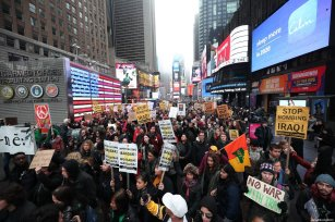 Anti-war activists take part in a protest organised by 'Answer Coalition' at Times Square following the killing of Iranian Revolutionary Guards' Quds Force commander Qasem Soleimani by a US airstrike in the Iraqi capital Baghdad, on January 4, 2020 in New York, United States [Tayfun Coşkun / Anadolu Agency]