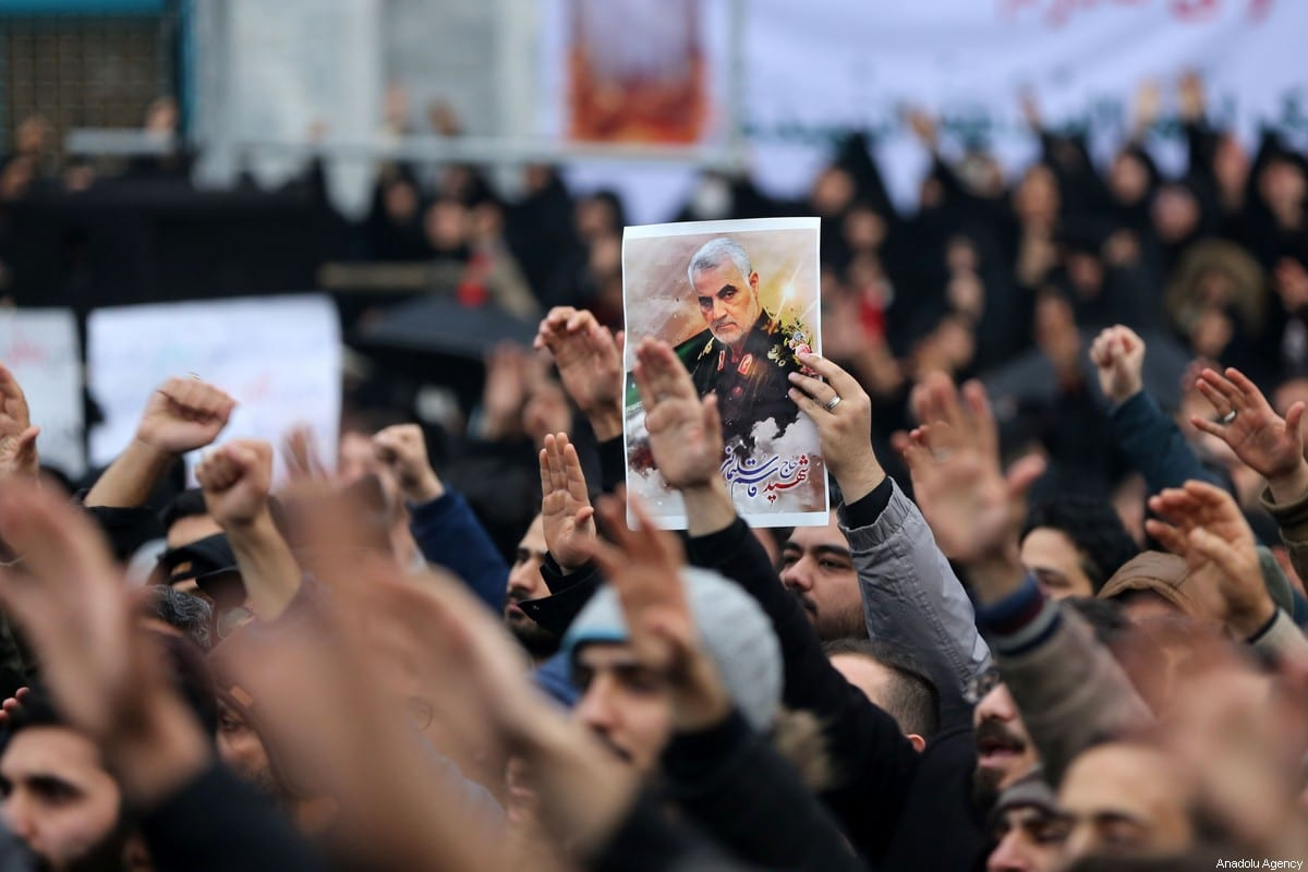 A demonstrator carries an image of Iranian Revolutionary Guards' Quds Force commander Qasem Soleimani, who was killed by a US airstrike in the Iraqi capital Baghdad, during an anti-US rally to protest the killing at Palestine Square in the capital Tehran, Iran on January 4, 2020 [Fatemeh Bahrami / Anadolu Agency]