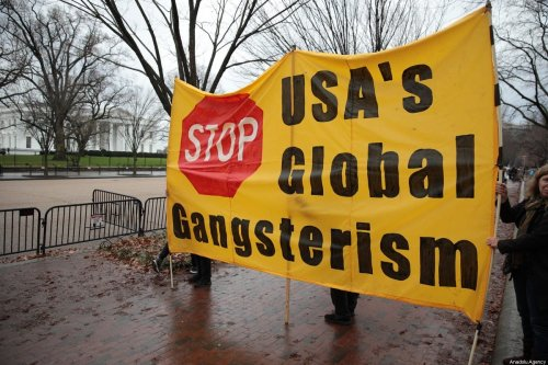 Anti-war activists hold banners during a protest organised by 'CodePink' in front of the White House following the killing of Iranian Revolutionary Guards' Quds Force commander Qasem Soleimani by a US airstrike in the Iraqi capital Baghdad, on 4 January 2020 in Washington, United States [Yasin Öztürk / Anadolu Agency]