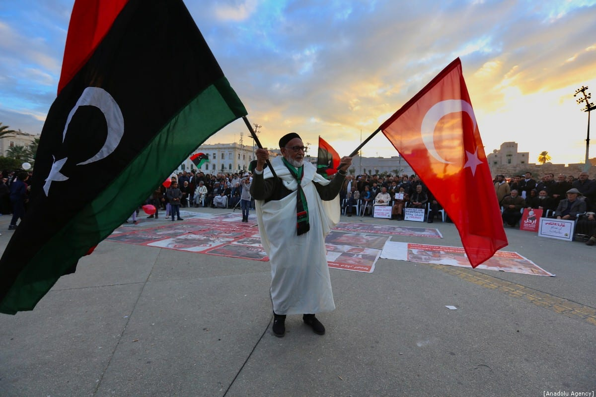 An old man holds flags of Turkey and Libya during a demonstration against eastern military commander Khalifa Haftar, who is based in the east of the country, and in support of the UN-recognised government of national accord (GNA) at Martyrs' Square in Tripoli on 10 January 2020. [Hazem Turkia - Anadolu Agency]