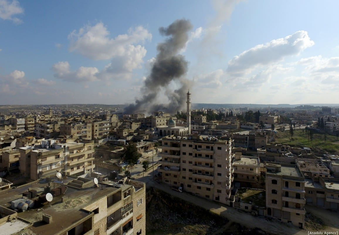 Drone photo shows smoke billowing from Maarat Al-Numan district after hit by Assad Regime forces' airstrikes in Idlib, Syria on January 11, 2020 [İzzeddin İdilbi/Anadolu Agency]