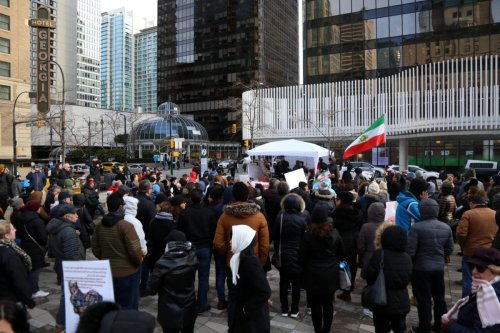 People stage a demonstration for the victims of a plane crash in Iran and against the Iranian government in Vancouver, B.C., Canada on January 11, 2020 [Mert Alper Derviş/Anadolu Agency]