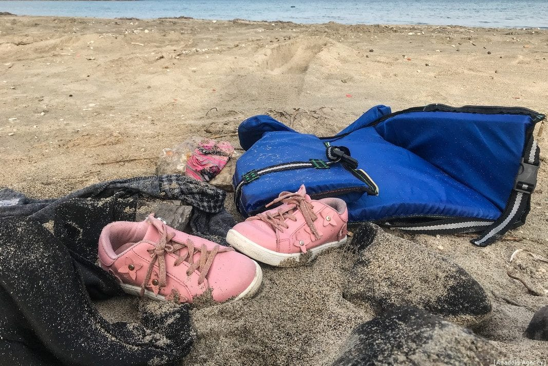 A pair of a child's shoes is seen after a boat carrying migrants capsized off the coast of Cesme in the Aegean province of Izmir, Turkey on January 12, 2020 [Mahmut Serdar Alakuş / Anadolu Agency]