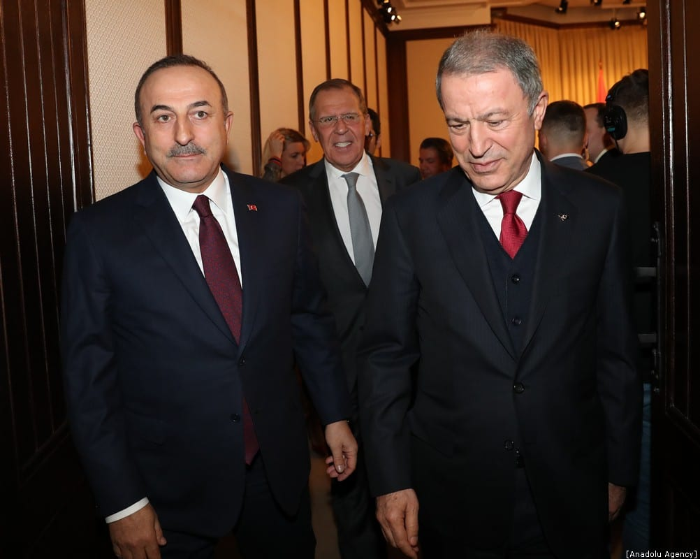 Turkish Foreign Minister Mevlut Cavusoglu (L) and Russian Foreign Minister Sergey Lavrov (C) arrice to hold a press conference with Defence Minister of Turkey Hulusi Akar (R) following their meeting on the efforts to ensure peace and stability in Libya on January 13, 2020 in Moscow, Russia. [Cem Özdel/Anadolu Agency]