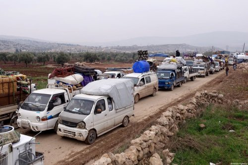 Syrian civilians, who have been displaced due to the ongoing attacks carried out by Assad regime and Russia, are seen on their way to safer zones with their belongings, at Atme camps in Idlib, Syria on January 19, 2020 [Ibrahim Dervis / Anadolu Agency]