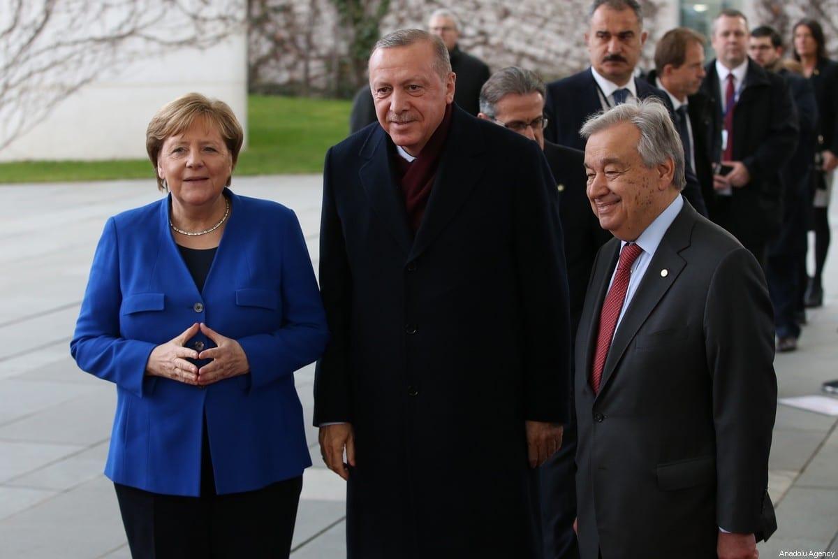 President of Turkey Recep Tayyip Erdogan (C), German Chancellor Angela Merkel and United Nations Secretary-General, Antonio Guterres (R) pose for a photo within the Berlin Conference on Libyan peace in Berlin, Germany on January 19, 2020 [Murat Kula/Anadolu Agency]