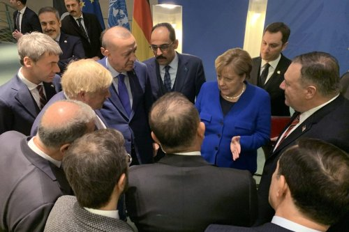 President of Turkey Recep Tayyip Erdogan meets German Chancellor Angela Merkel within the Berlin Conference on Libyan peace in Berlin, Germany on 19 January 2020. [Turkish Presidency / Murat Cetinmuhurdar - Anadolu Agency]