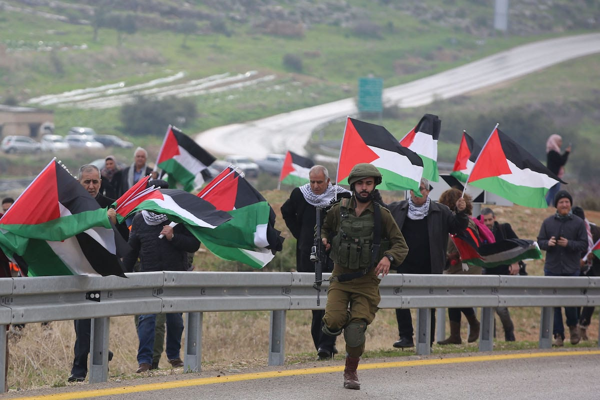 Palestinians protest against US President Donald Trump's peace plan in Jordan Valley, West Bank on 29 January, 2020 [Issam Rimawi/Anadolu Agency]