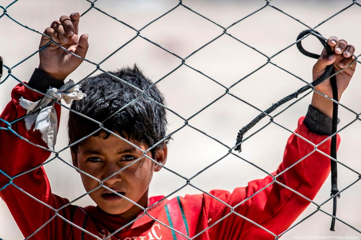 A Syrian child looks on in the Al-Hol camp in Syria, on 8 August 2019 pDELIL SOULEIMAN/AFP/Getty Images]