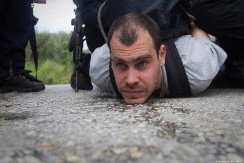 Israeli anti-occupation activist Jonathan Pollak is arrested by Israeli forces, 7 January 2020 [Roznama Quds/Twitter]
