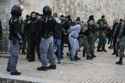 Israeli police arrests a Palestinian man outside the Al-Aqsa Mosque Compound in Eastern Jerusalem on 29 January 2020 [Mostafa Alkharouf/Anadolu Agency]