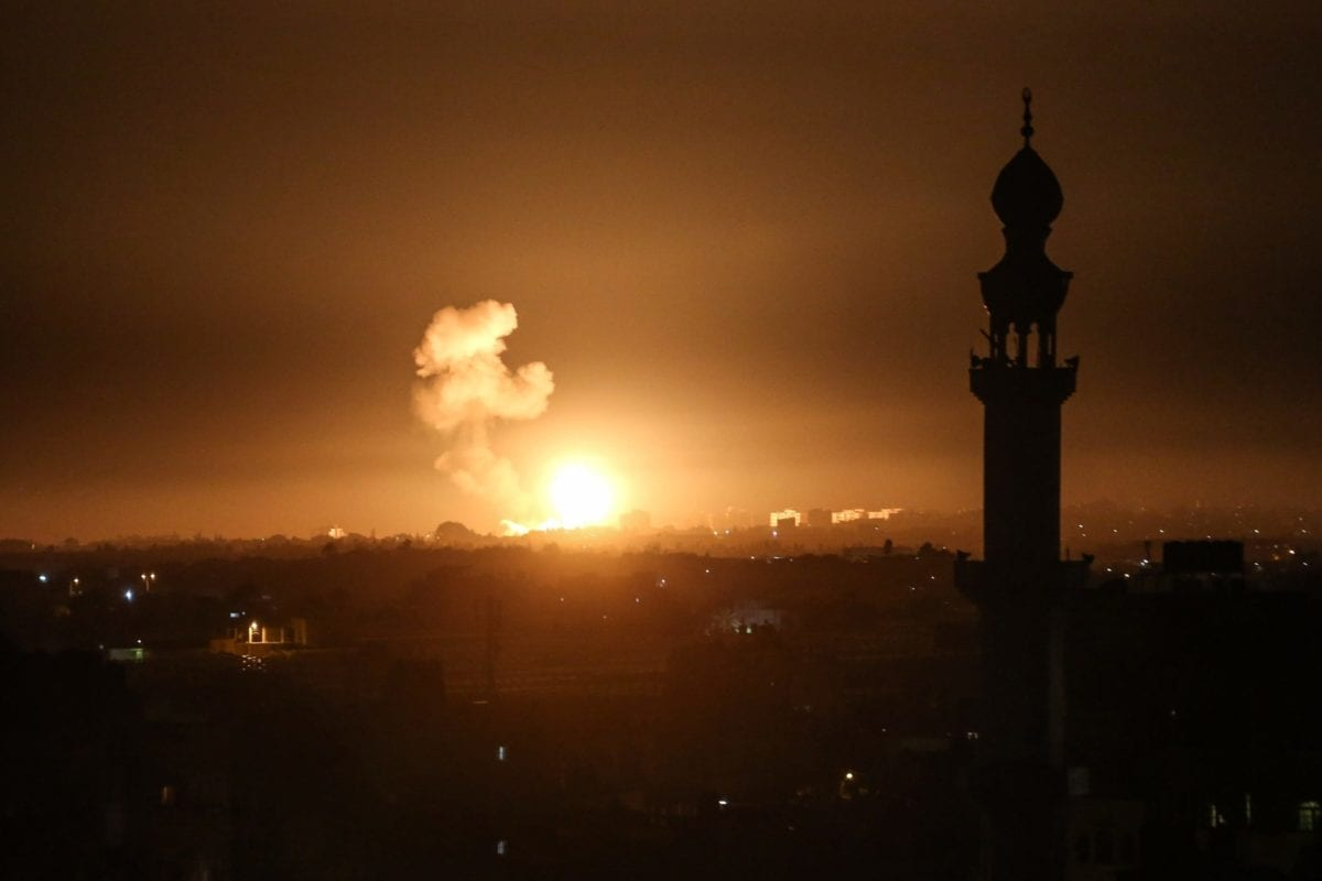 Smoke rises and explosion illuminates the night sky after Israel launched airstrikes targeting positions of the Izz ad-Din al-Qassam Brigades, Hamas' military wing in Khan Yunis, Gaza on 5 February 2020. [Abed Rahim Khatib - Anadolu Agency]