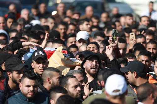 People carry the dead body of 19-year-old Yazan Abu Tabikh, who succumbed to his wounds at Doctor Khalil Suleiman Hospital after being shot by Israeli forces in a brawl between Israeli soldiers and Palestinian youth, during his funeral ceremony in Jenin, West Bank on 6 February, 2020 [Issam Rimawi/Anadolu Agency]