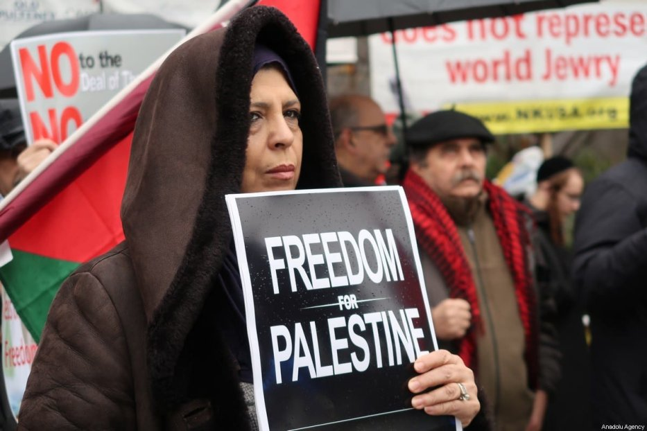 group of protesters gather in front of United Nations headquarters to protest against U.S. President Donald Trump's Middle East plan as Palestinian President, Mahmoud Abbas speaks at the UN Security Council meeting in New York, United States on 11 February 2020. [Islam Doğru - Anadolu Agency]