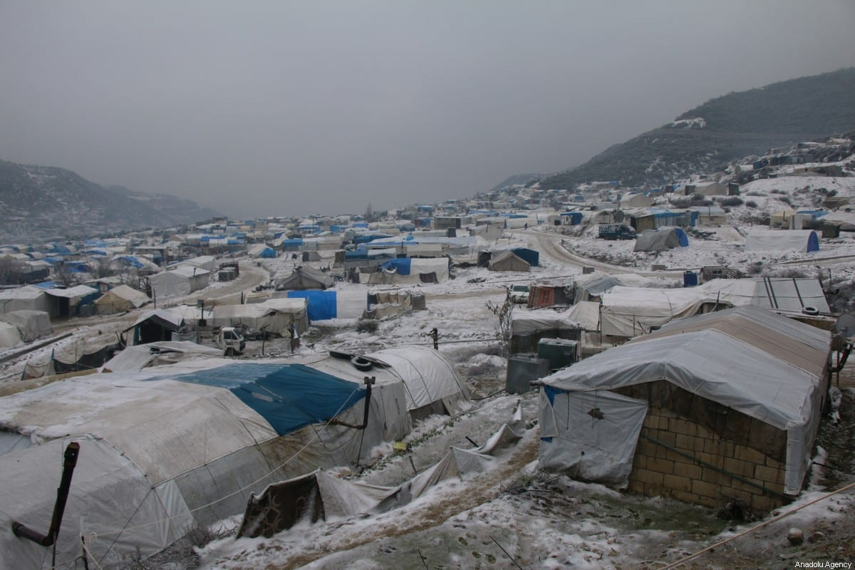 An overlook of a refugee camp during a freezing cold day in Idlib, Syria on February 13, 2020. Many civilians have left their homes in northwest Syria due to the attacks by Assad regime forces and their allies. Winter conditions make their struggle harder. ( Hadi Harrat - Anadolu Agency )