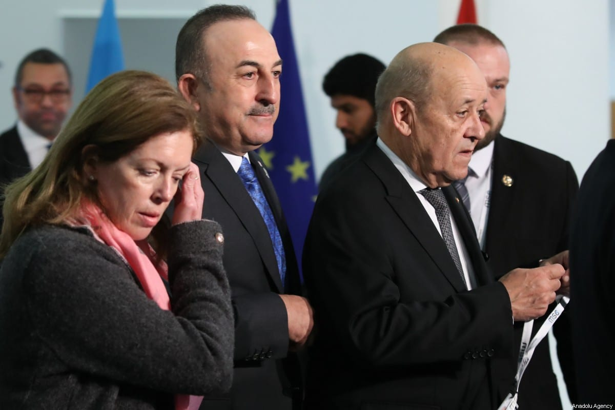 Turkish Foreign Minister Mevlut Cavusoglu (2nd L) takes part in a family photo within foreign ministers' meeting to discuss recent efforts for cease-fire in Libya as part of Berlin Process in Munich, Germany on February 16, 2020. [Cem Özdel - Anadolu Agency]