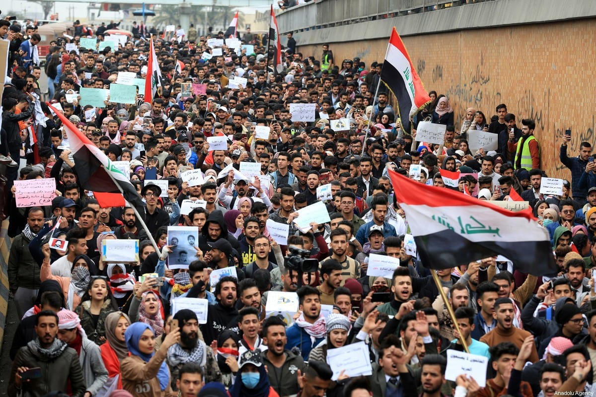 University and high-school students walk towards Tahrir Square to support anti-government protesters in Baghdad, Iraq on 16 February 2020 [Murtadha Al-Sudani - Anadolu Agency]