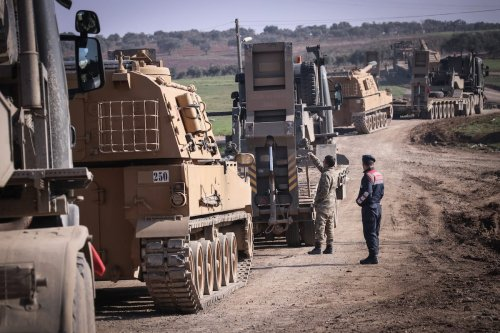 Total of 150 military vehicles of Turkish Armed Forces' pass through Reyhanli district of Turkey's Hatay as they are being deployed to Syria border as reinforcements, including howitzers, tanks, ammunition, armored construction machines and other military vehicles on 17 February 2020. [Burak Milli - Anadolu Agency]