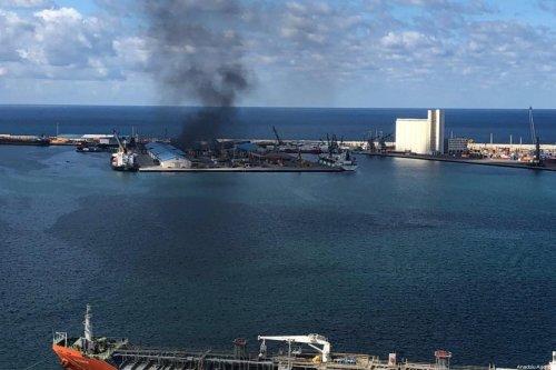 Smoke rises after Khalifa Haftar's forces launched an attack on a port in eastern Tripoli, Libya on 18 February 2020 [Aydoğan Kalabalık/Anadolu Agency]